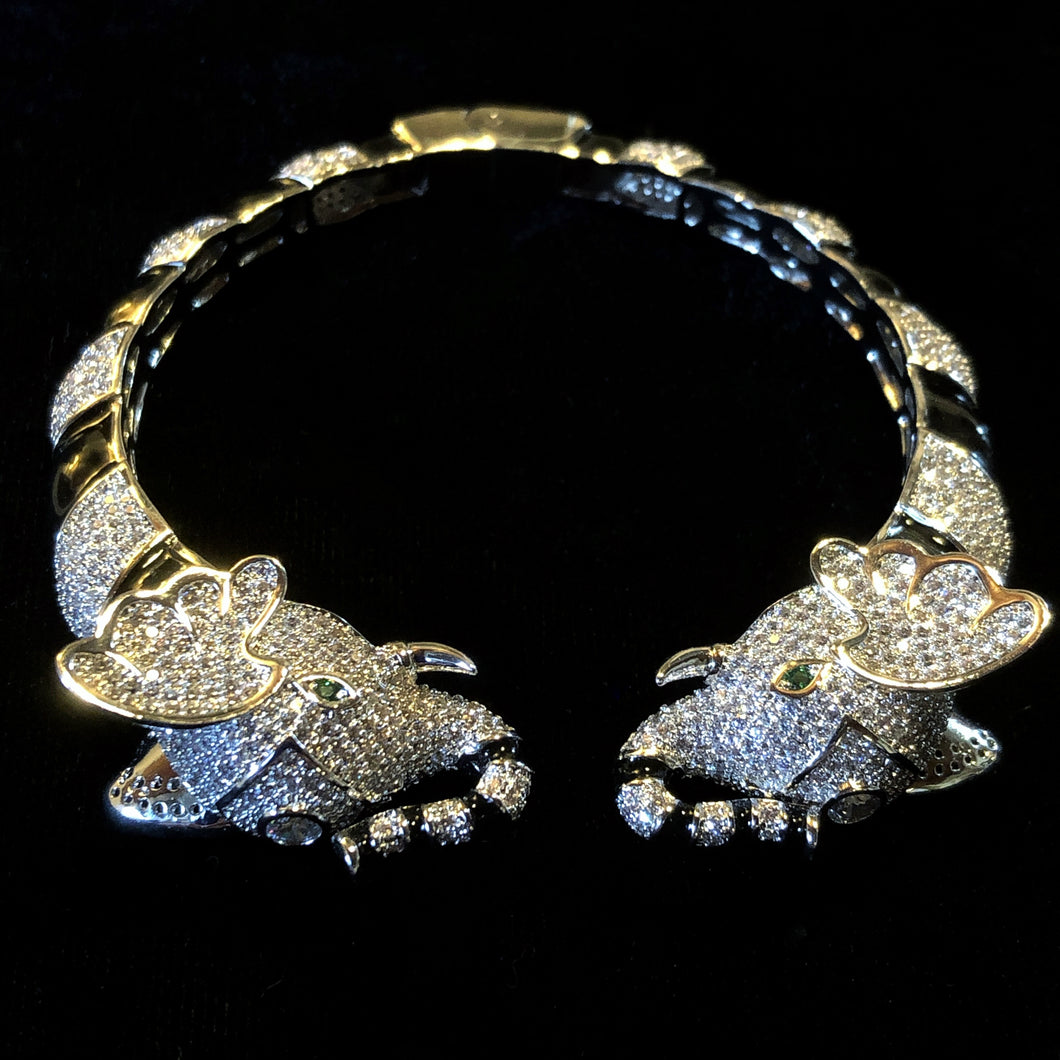 A BLACK ENAMELLED AND DIAMANTÉ ELEPHANT BRACELET