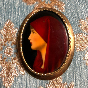 AN ANTIQUE HAND PAINTED ENAMEL BROOCH OF SAINT FABIOLA.