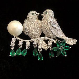 TWO BIRDS ON A BRANCH BROOCH WITH SINGLE PEARL