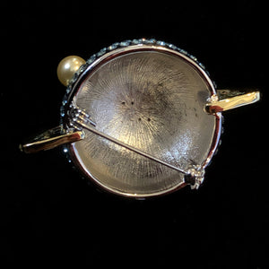 A DIAMANTÉ SATURN BROOCH