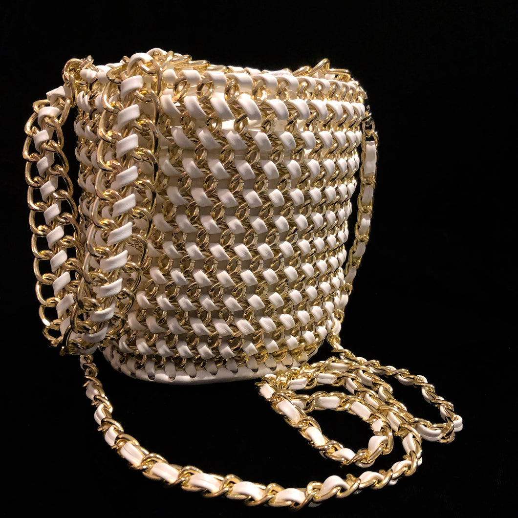 A WOVEN WHITE PVC AND GILT CHAIN BUCKET BAG
