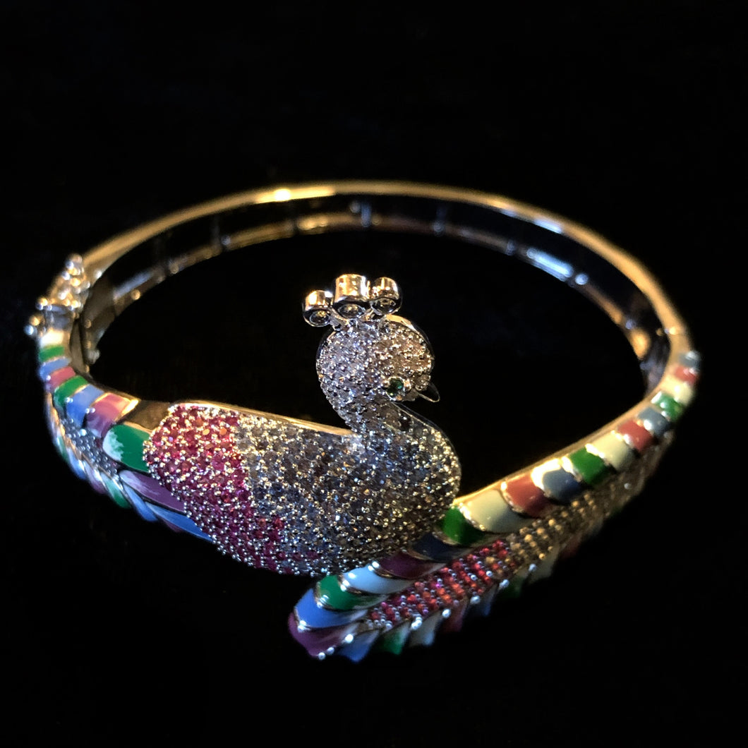 AN ENAMELLED AND PAVÉ SET DIAMANTÉ PEACOCK BRACELET
