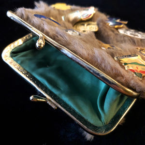 A KANGAROO SKIN PURSE WITH 28 VINTAGE GIRL GUIDE PINS.