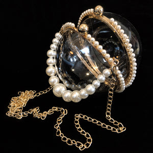 A PERSPEX SPHERICAL EVENING BAG WITH PEARLS