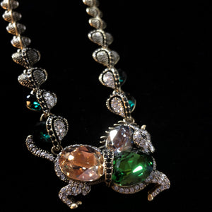 A JEWELLED HORSE NECKLACE