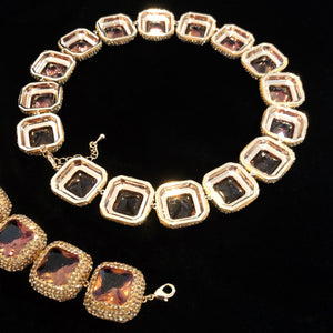 AN INTRIGUING SQUARE CRYSTAL LOZENGE CHOKER AND BRACELET