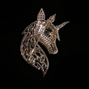 A MYSTICAL DIAMANTÉ UNICORN BROOCH