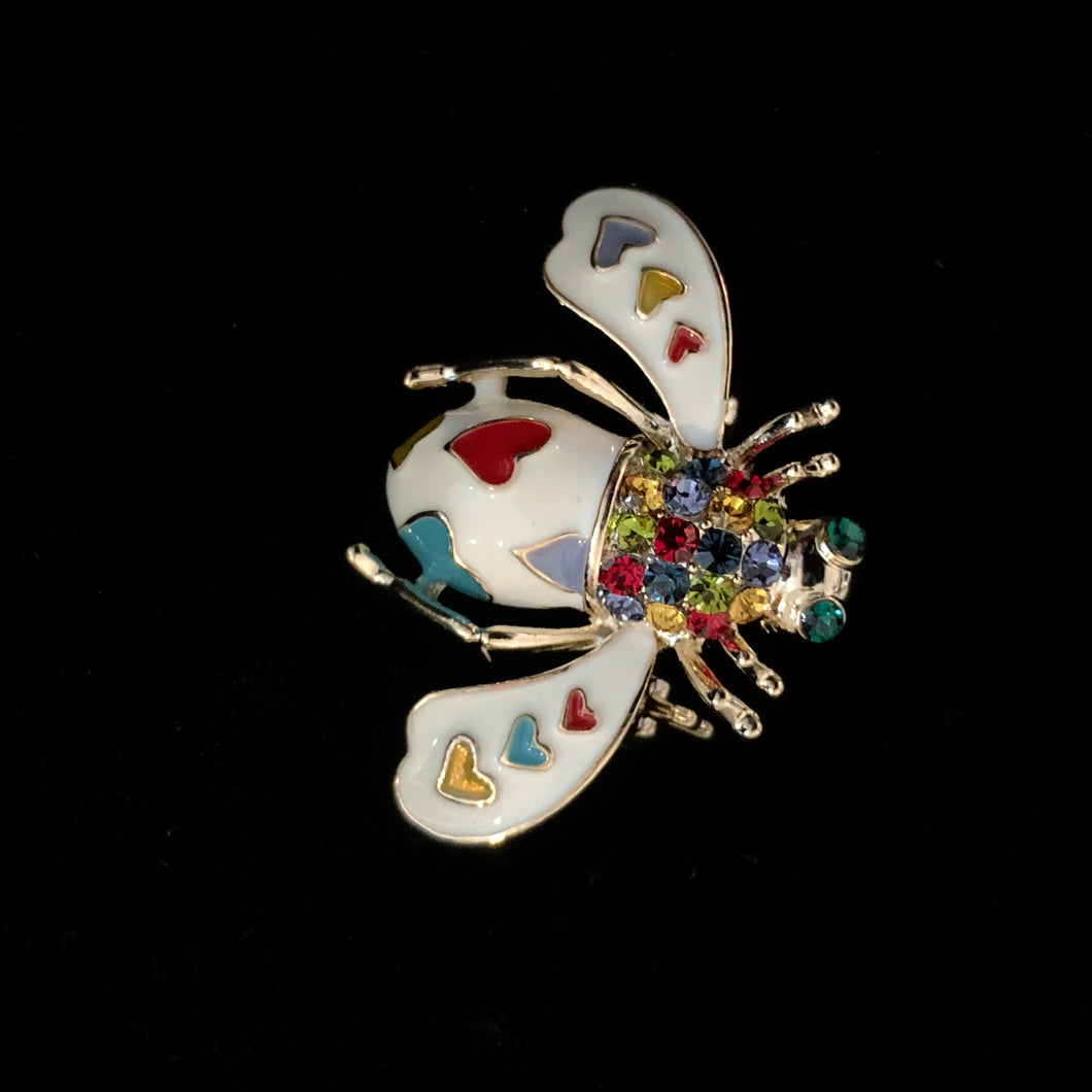 A WHITE ENAMEL BEE BROOCH WITH HEARTS