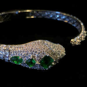 A DIAMANTÉ SNAKE BRACELET WITH GREEN JEWELS