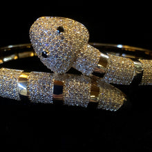 Load image into Gallery viewer, A GOLD TONE BANDED DIAMANTÉ SNAKE BRACELET