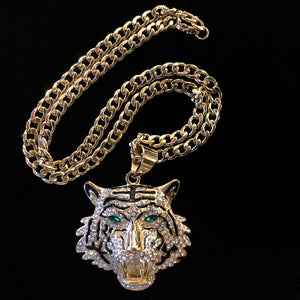 A LARGE GILT TIGER HEAD PENDANT