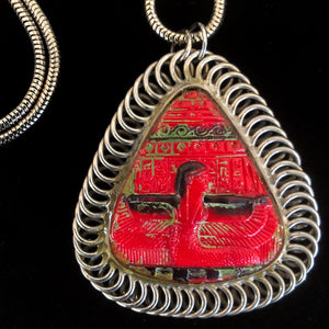 A 1970s ART PENDANT FEATURING AN ORIGINAL 1930s EGYPTIAN-REVIVAL GLASS AMULET