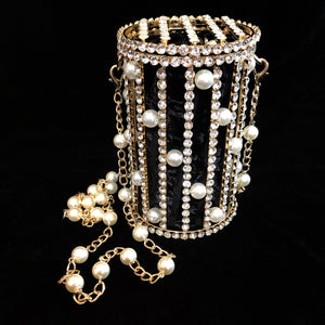A RHINESTONE AND PEARL CAGE STYLE EVENING BAG