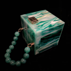A MARBLED PERSPEX CUBE BAG