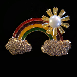 A RAINBOW WEATHER BROOCH WITH SPINNING SUN
