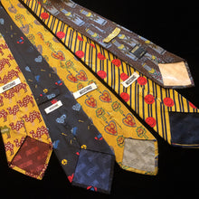 Load image into Gallery viewer, A COLLECTION OF VINTAGE MOSCHINO SILK TIES