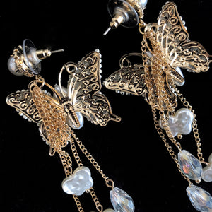 A PAIR OF ROMANTIC FAUX PEARL BUTTERFLY EARRINGS
