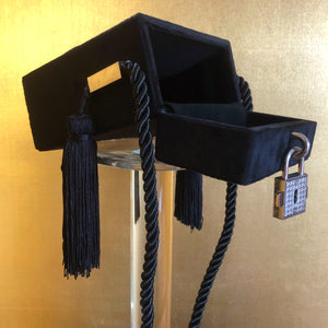 A BLACK FLOCKED EVENING CASE WITH TASSELS