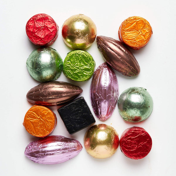 Assorted flavoured solid chocolates wrapped in colourful foils