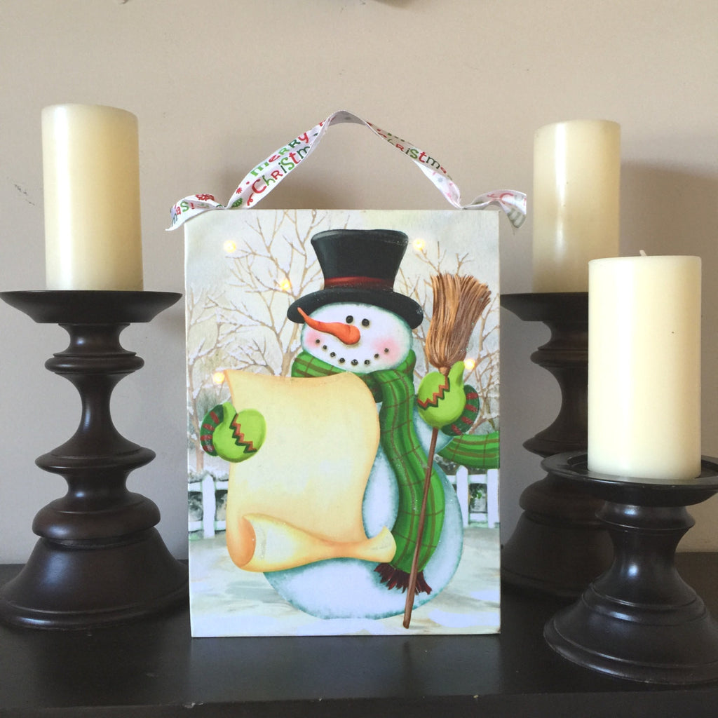 Snowman With A Hat Holding A List Lighted Canvas Wall Art Print