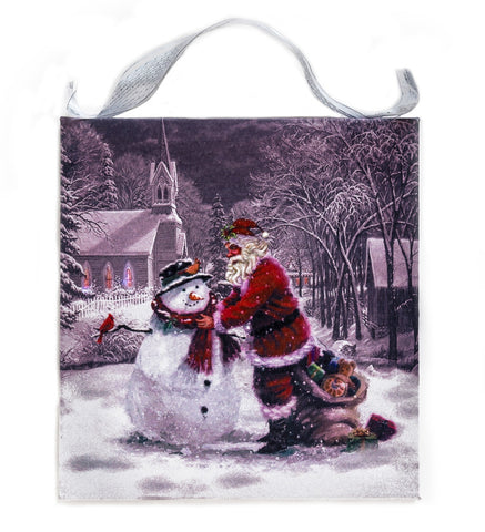 Santa Claus and Snowman in a winter scene with Church Lighted Sign Canvas Wall Art Print
