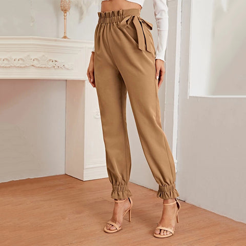 Large size tapered pants with a knotted waist