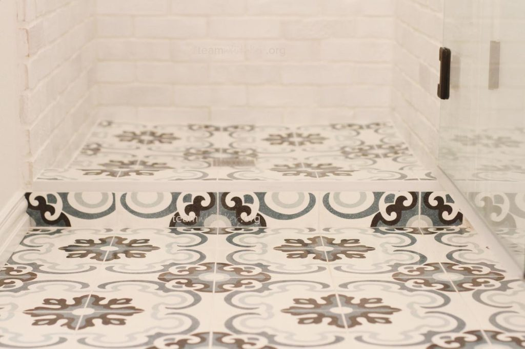 After Mater Bathroom Reno : The tile rolled on into the shower floor
