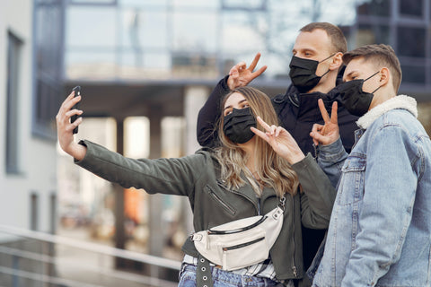 friends taking a selfie wearing face masks masks made in usa