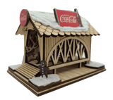Ginger Cottage Coke a Cola Covered Bridge Christmas Village - Schmidt Christmas Market زينة عيد الميلاد