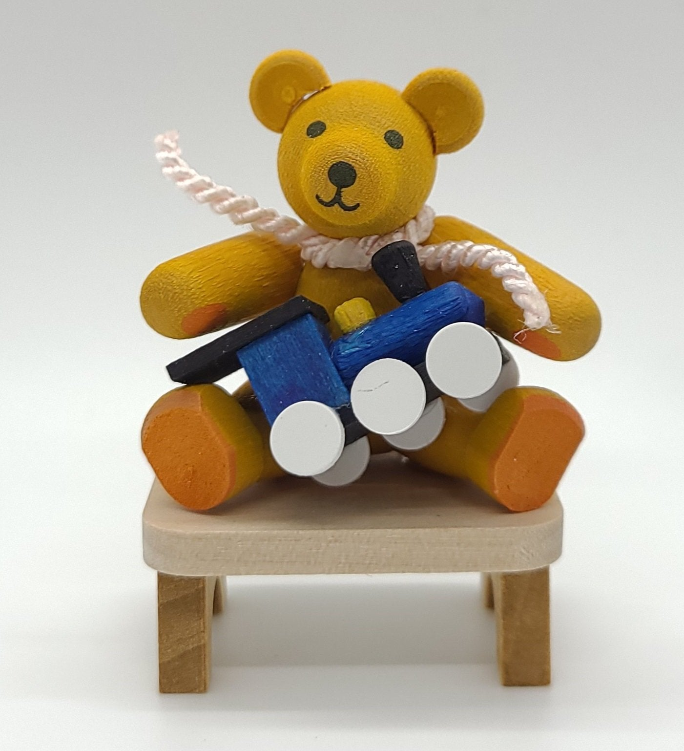 Handmade Yellow Bear with Toy on a Bench - Schmidt Christmas Market Christmas Decoration