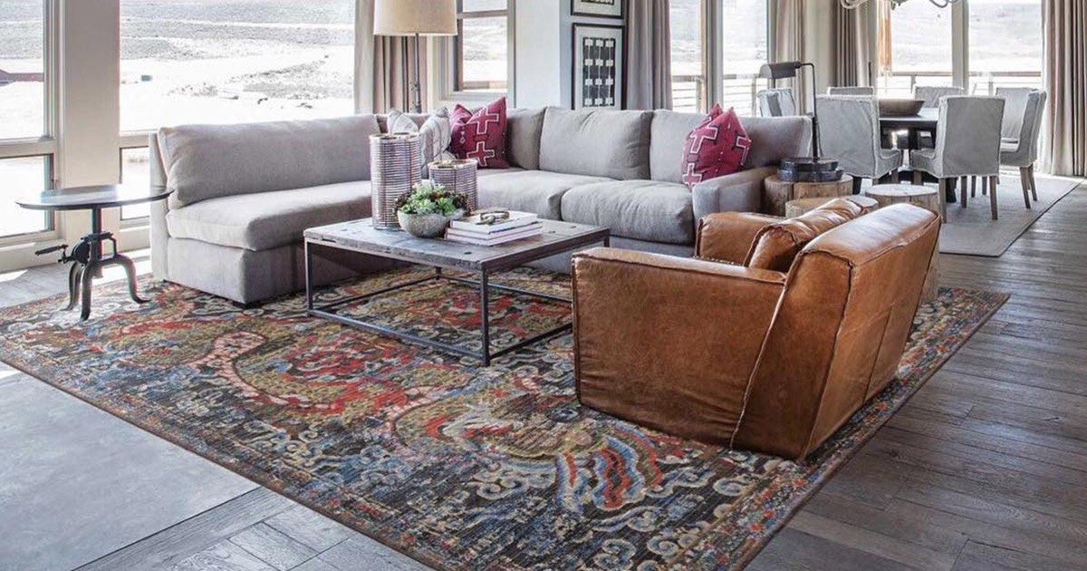 Living room rug on top of carpet top 7 area rug tips for Can you put an area rug on carpet