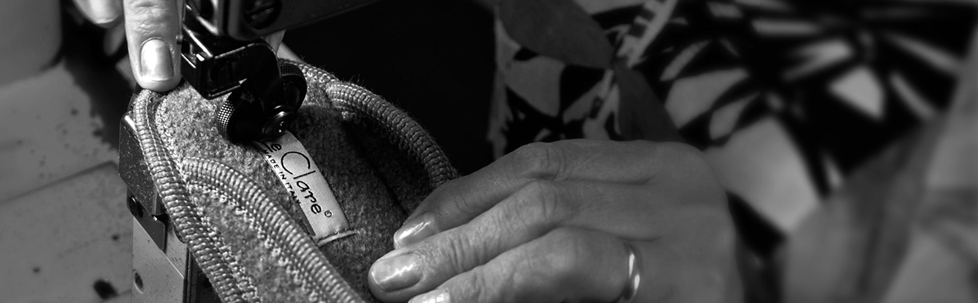 Woman hand sewing a pair of Le Clare slippers