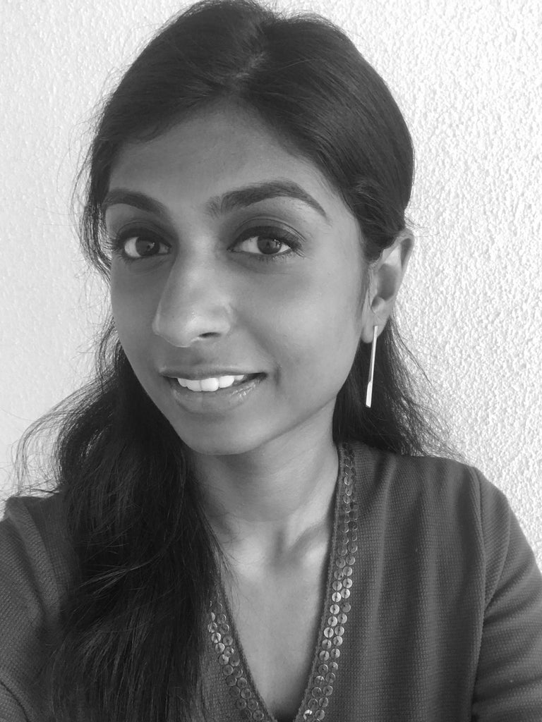 Diya wearing our Obelisk Earrings