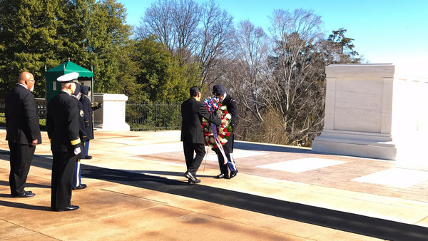 Laying a wreath at Arlington National Cemetery