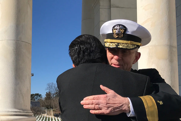An embrace at Arlington National Cemetery