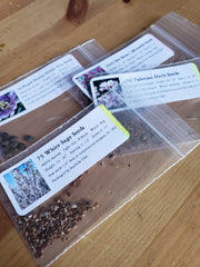 packets of valerian, white sage, lemon bee balm, and purple passion flower seeds
