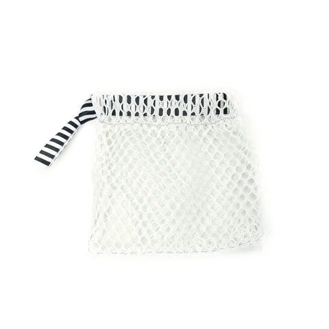 A squarish net bag with a black and white striped drawstring ribbbon.