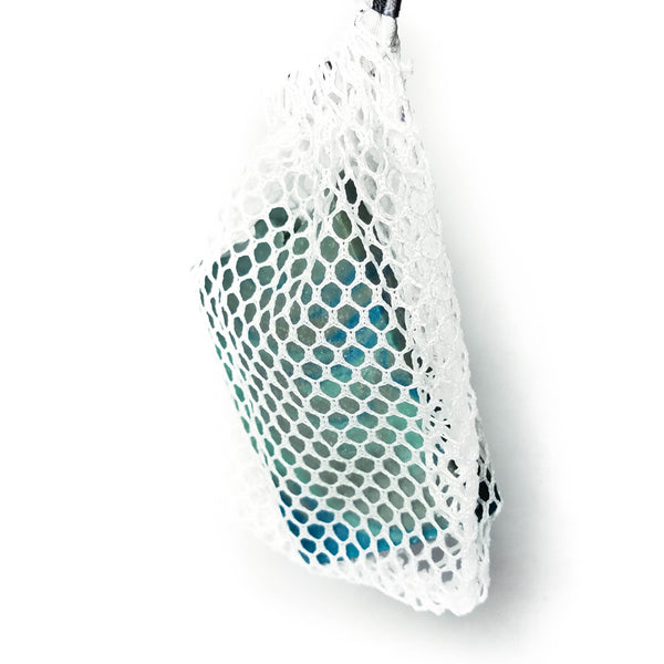 Net soap saver hanging with a bar of soap inside.