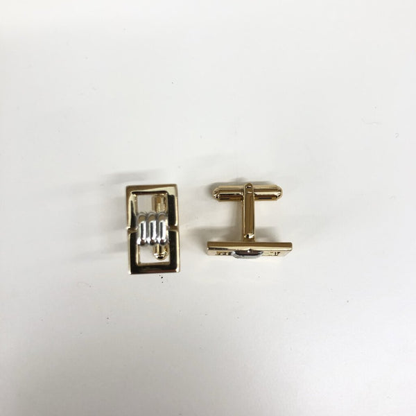 gold tone and silver cuff links