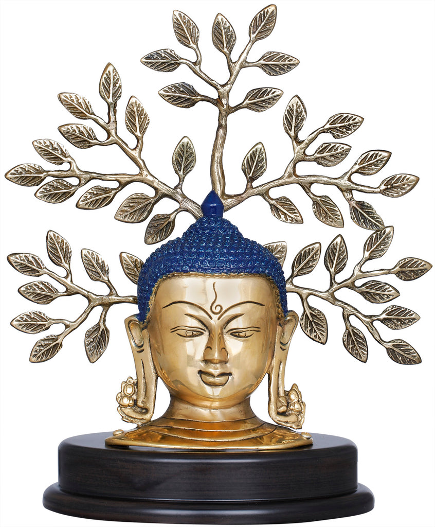 Lord Buddha Mask On a Wooden Base and Tree as a Backdrop