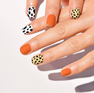 Hello Birdie Nail Art with a mix of solid orange, black and white animal print and pale yellow and black animal print.
