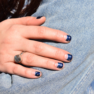 Hello birdie nail art with negative space moons, a shimmery navy base and white four point stars.