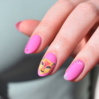 Hello Birdie Nail Art on one hand with bubblegum pink base and illustrated exotic cat face on one nail.