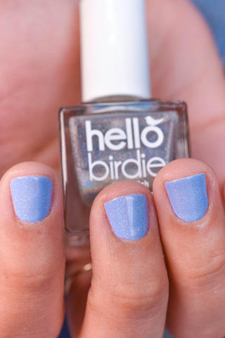 Hello Birdie Peacocking holographic top coat on a lavender polish