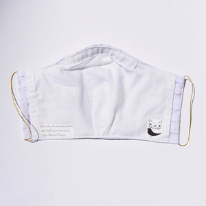 Inside Crooked Cat face mask with a white cotton material, song lyrics and logos