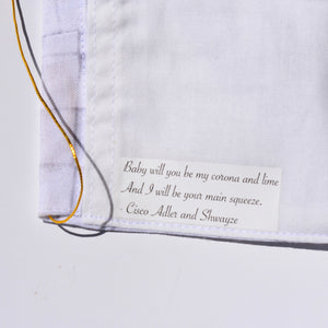 Inside white cloth on cotton face mask has a Cisco Adler and Shwayze quote printed on it.