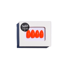 Four press-ons packaged in a rectangular box with a Hello Birdie logo on the top left corner.  A window with rounded corners allows you to view the vibrant and bright orange glossy almond shaped nails.