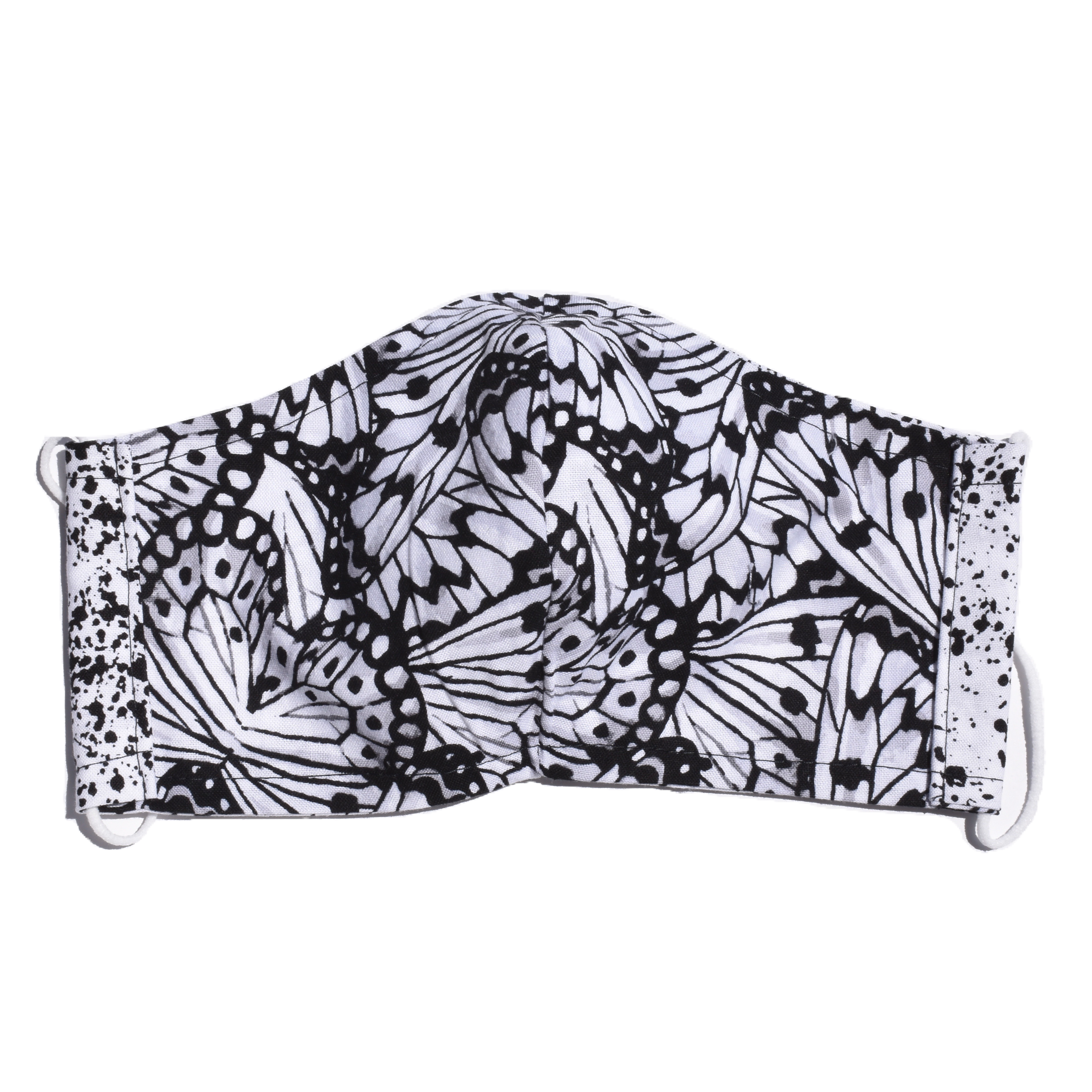 view of other side of face mask showing white material with black butterfly wings on inside.