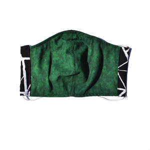 view of other side of mask showing green dye material