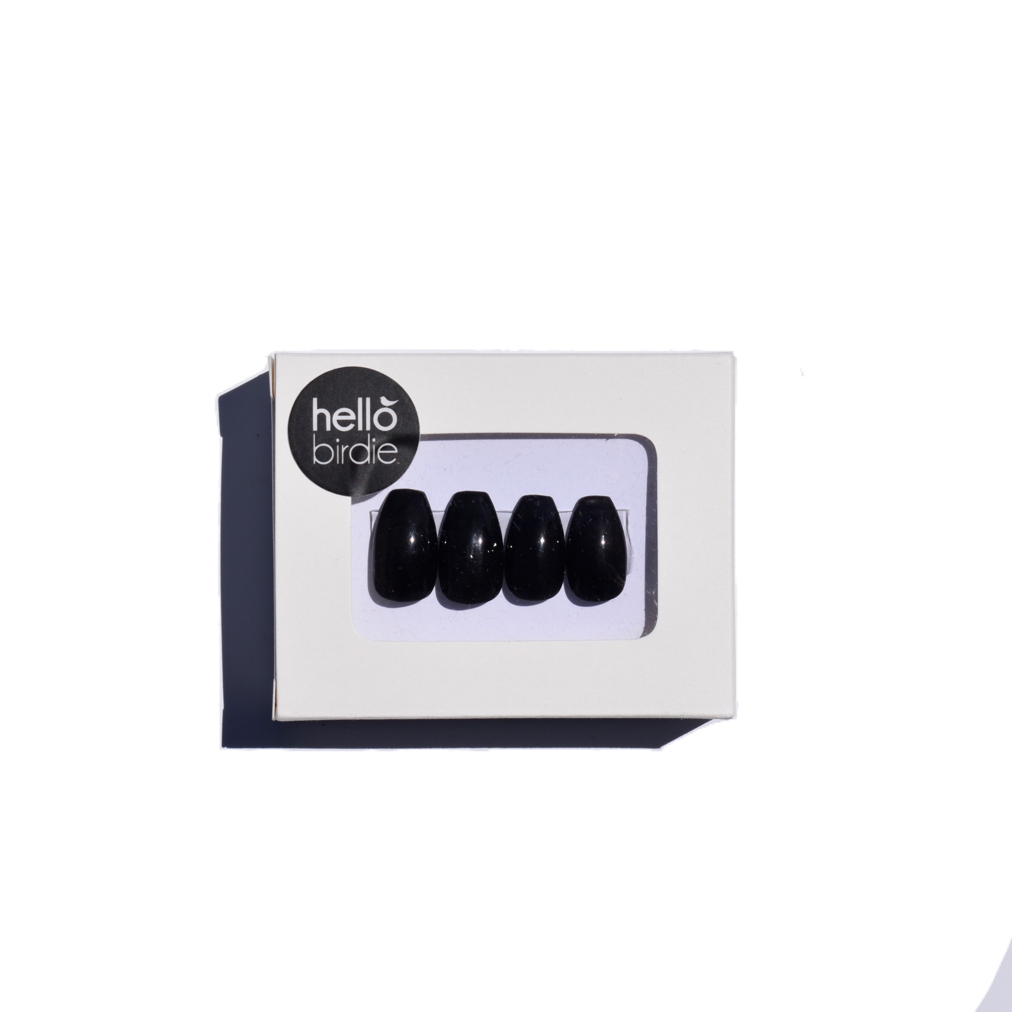 Four press-ons packaged in a rectangular box with a round  hello birdie logo on the top left corner.  A window with rounded corners allows you to view the black press ons in a gloss finish.